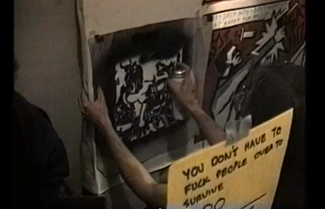"Stencil art going up at a WW3-related ""Paint Jam"" in 1990."