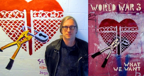 "Seth Tobocman posing in front of his original graffiti art, which served as the cover for World War 3 Illustrated's Issue #40: ""What We Want"""